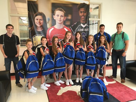Fluor College Interns Donate Backpacks to Middle Schools