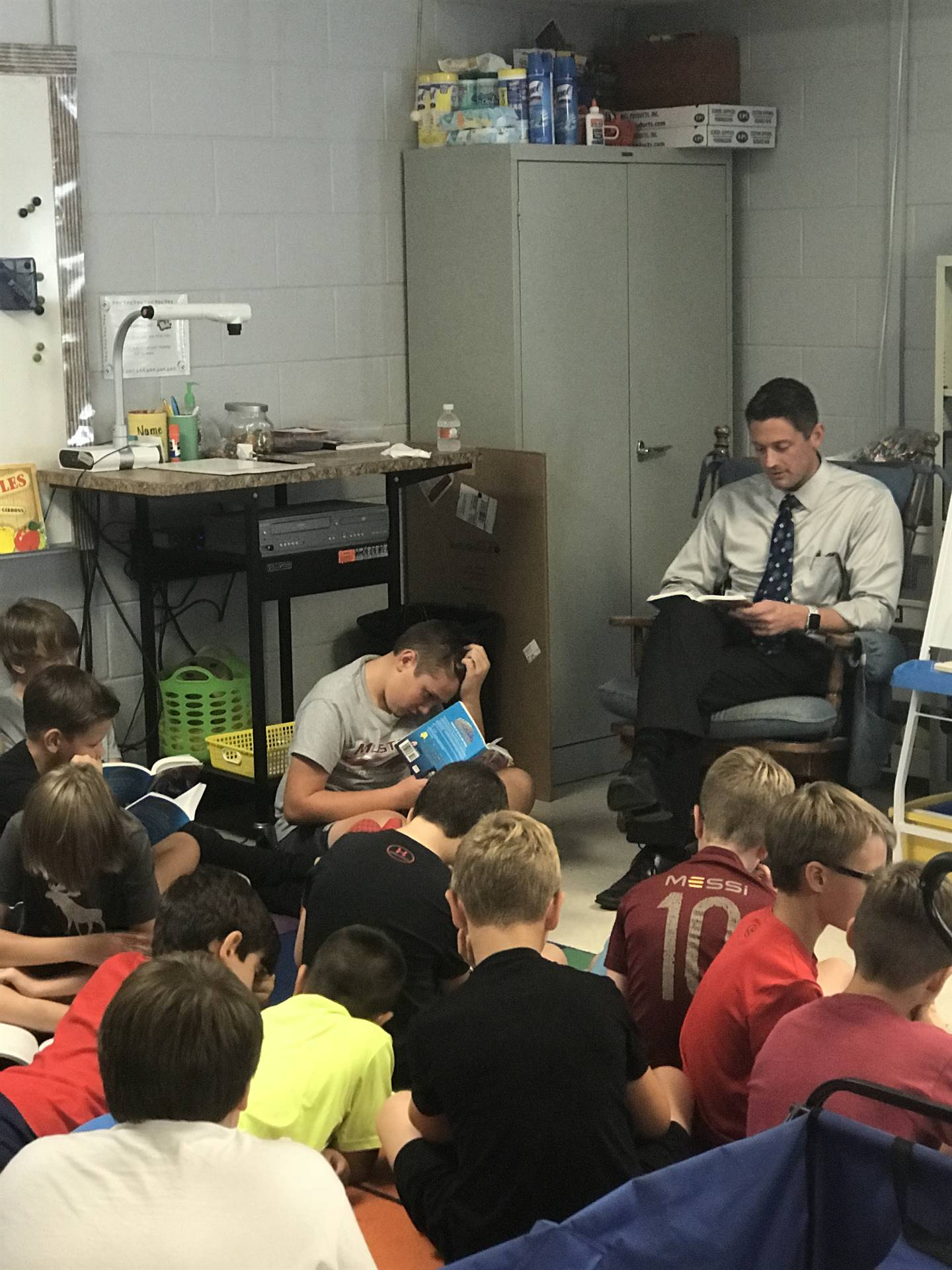 Boys book club with guest reader Mr. Edwards